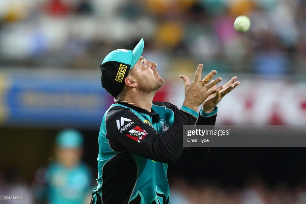 Brendon McCullum of the Heat takes a catch to dismiss George Bailey of the Hurricanes during the Big Bash League match between the Brisbane Heat and the Hobart Hurricanes at The Gabba on January 10, 2018 in Brisbane, Australia.