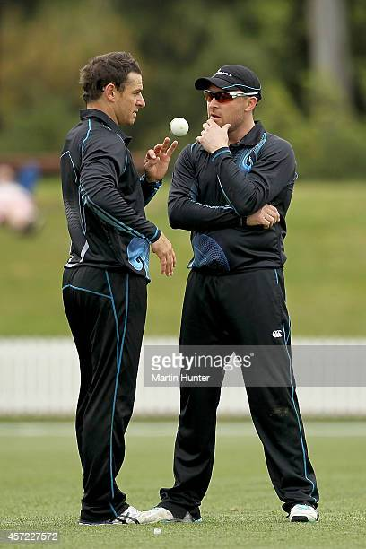 Brendon McCullum talks to his brother Nathan McCullum during the tour match between the New Zealand XI and Scotland on October 15 2014 at Bert...