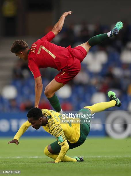 Brendon Moloisane of South Africa and Jota of Portugal in action during the 2019 FIFA U20 World Cup group F match between South Africa and Portugal...