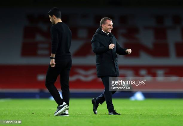 Brendon Rodgers manager of Leicester City celebrates as he walks past Mikel Arteta manager of Arsenal after the Premier League match between Arsenal...