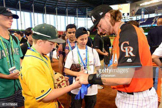 Brendon Rodgers of Team USA signs autographs during batting practice prior to the SirusXM AllStar Futures Game at Marlins Park on Sunday July 9 2017...