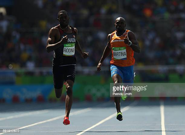 Brendon Rodney of Canada and Churandy Martina of the Netherlands compete during the Men's 200m Round 1 on Day 11 of the Rio 2016 Olympic Games at the...