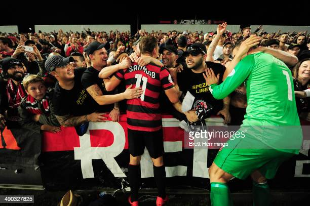 Brendon Santalab and Ante Covic of the Wanderers celebrate with fans after victory during the AFC Asian Champions League match between the Western...