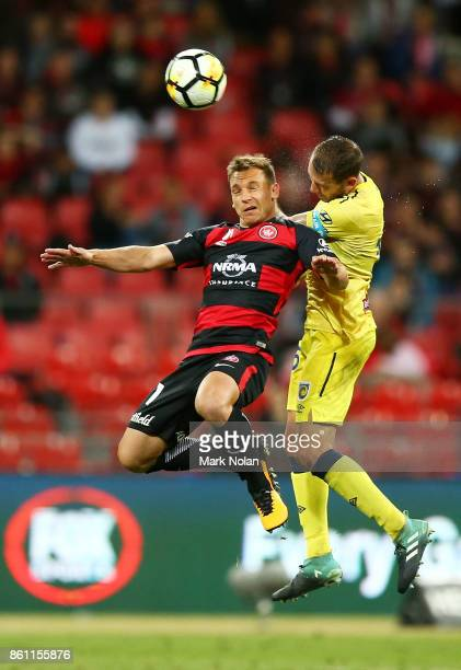 Brendon Santalab of the Wanderers and Alan Baro Calabuig of the Mariners contest possession during the round two ALeague match between the Western...