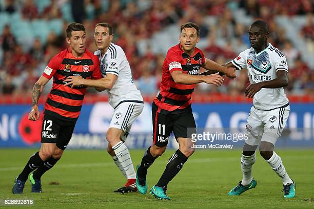 Brendon Santalab of the Wanderers and Jason Geria of the Victory watch on during the round 10 ALeague match between the Western Sydney Wanderers and...
