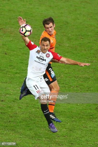 Brendon Santalab of the Wanderers and Luke De Vere of the Roar compete for the ball during the ALeague Elimination Final match between the Brisbane...