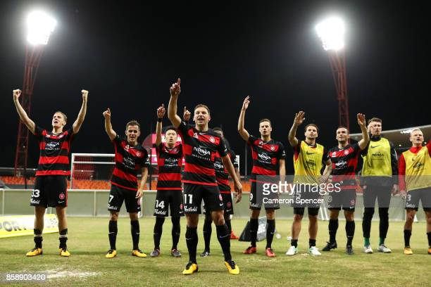 Brendon Santalab of the Wanderers and team mates thank fans after winning the round one ALeague match between the Western Sydney Wanderers and the...