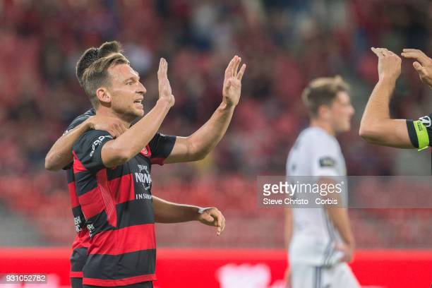 Brendon Santalab of the Wanderers celebrates scoring a goal with teammate Christopher Iknoomidis during the round 22 ALeague match between the...