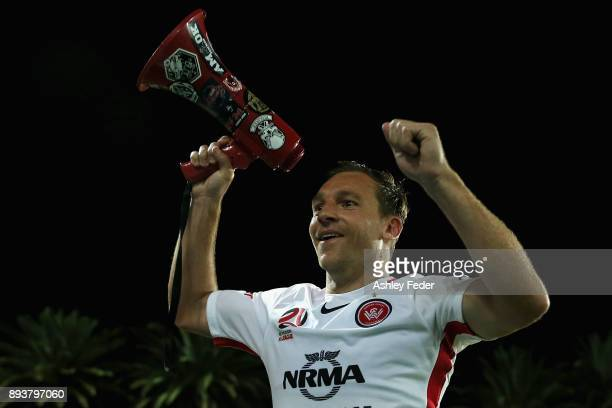 Brendon Santalab of the Wanderers celebrates the win with the fan club megaphone during the round 11 ALeague match between the Central Coast and the...