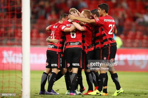 Brendon Santalab of the Wanderers celebrates with team mates after scoring his second goal during the round 23 ALeague match between the Western...