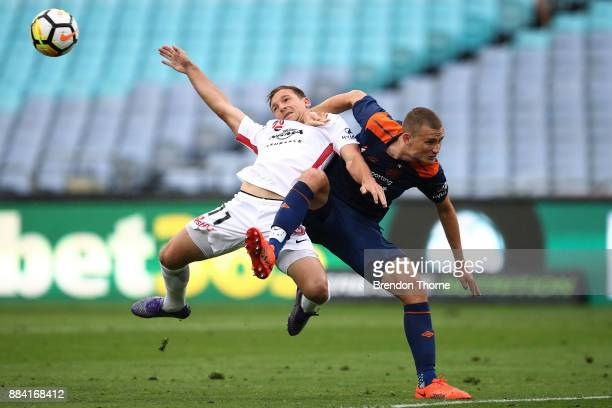 Brendon Santalab of the Wanderers competes with Daniel Bowles of the Roar during the round nine ALeague match between the Western Sydney Wanderers...
