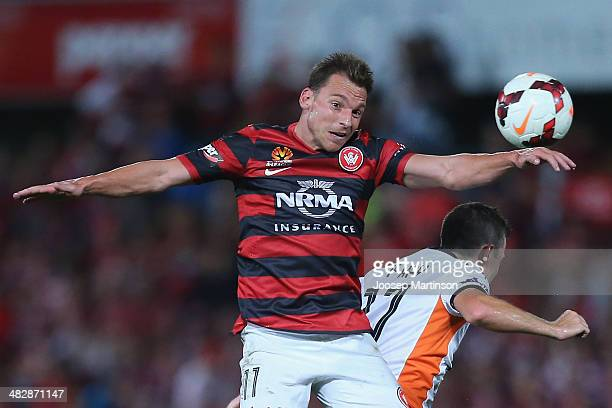 Brendon Santalab of the Wanderers competes with Liam Miller of the Roar during the round 26 ALeague match between the Western Sydney Wanderers and...
