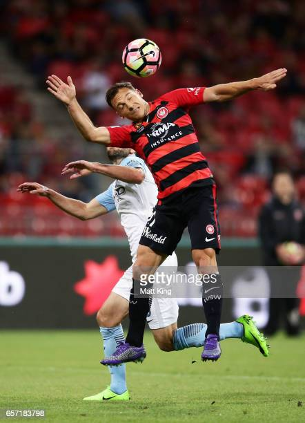 Brendon Santalab of the Wanderers heads the ball in front of Josh Rose of Melbourne City during the round 24 ALeague match between the Western Sydney...