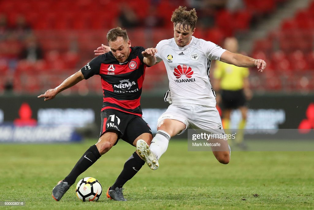 Brendon Santalab of the Wanderers is challenged by Dylan Fox of the Phoenix during the round 22 A-League match between the Western Sydney Wanderers and the Wellington Phoenix at Spotless Stadium on March 10, 2018 in Sydney, Australia.