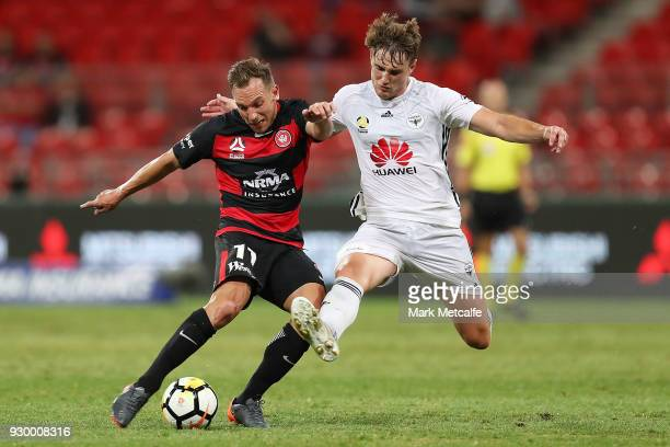 Brendon Santalab of the Wanderers is challenged by Dylan Fox of the Phoenix during the round 22 ALeague match between the Western Sydney Wanderers...