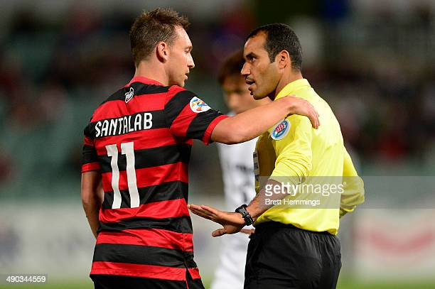 Brendon Santalab of the Wanderers speaks with Referee Nawaf Shukralla during the AFC Asian Champions League match between the Western Sydney...