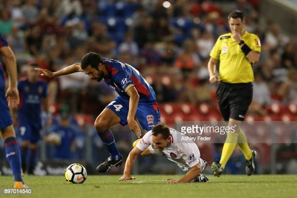 Brendon Santalab of Western Sydney contests the ball against Nikolai ToporStanley of the Jets during the round 12 ALeague match between the Newcastle...