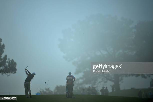 Brendon Todd hits a shot from the second fareway during the final round of the Farmers Insurance Open on Torrey Pines South on January 26 2014 in La...