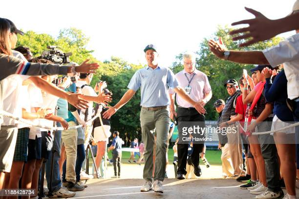 Brendon Todd of the United States celebrates with fans as he walks from the 18th green after winning the Mayakoba Golf Classic at El Camaleon...