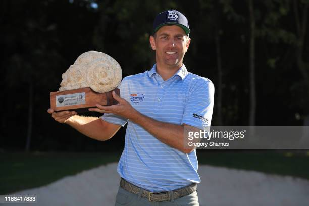 Brendon Todd of the United States celebrates with the trophy on the 18th green after winning the Mayakoba Golf Classic at El Camaleon Mayakoba Golf...