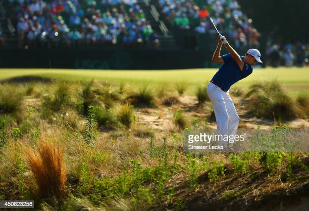 Brendon Todd of the United States hits an approach shot on the 11th hole during the third round of the 114th US Open at Pinehurst Resort Country Club...
