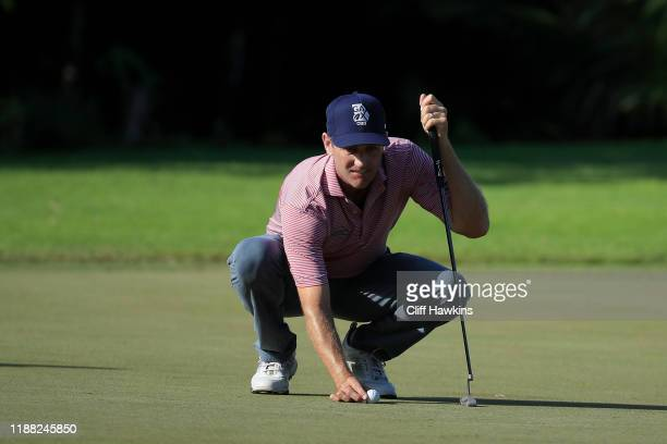 Brendon Todd of the United States lines up a putt on the first green during the third round of the Mayakoba Golf Classic at El Camaleon Mayakoba Golf...