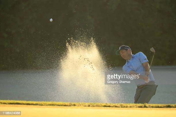 Brendon Todd of the United States plays a shot from a bunker on the 16th hole during the continuation of the final round of the Mayakoba Golf Classic...