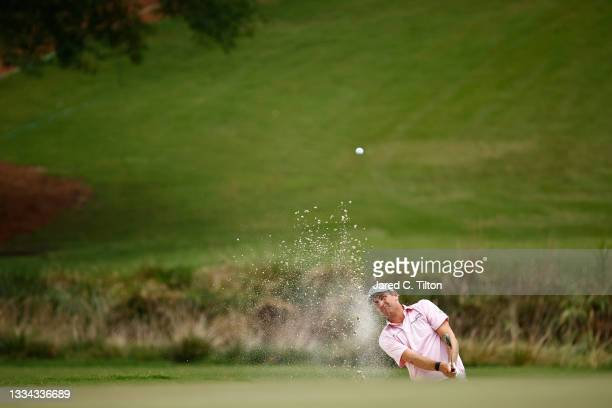 Brendon Todd of the United States plays a shot from a bunker on the 18th hole during the final round of the Wyndham Championship at Sedgefield...