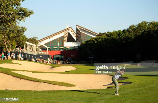 Brendon Todd of the United States plays his second shot on the 18th hole during the continuation of the final round of the Mayakoba Golf Classic at...