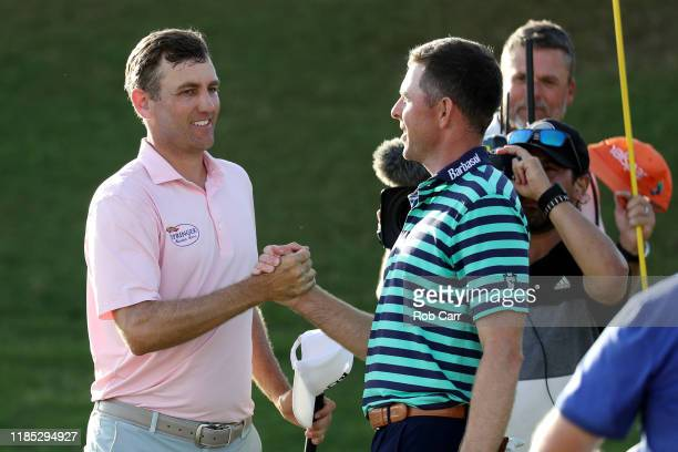 Brendon Todd of the United States shakes hands with Bo Hoag of the United States after winning during the final round of the Bermuda Championship at...