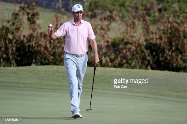 Brendon Todd of the United States waves after putting on the 14th green during the final round of the Bermuda Championship at Port Royal Golf Course...