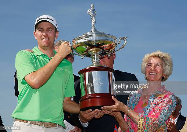 Brendon Todd poses with Peggy Nelson and the trophy after his victory at the HP Byron Nelson Championship at the TPC Four Seasons Resort on May 18...