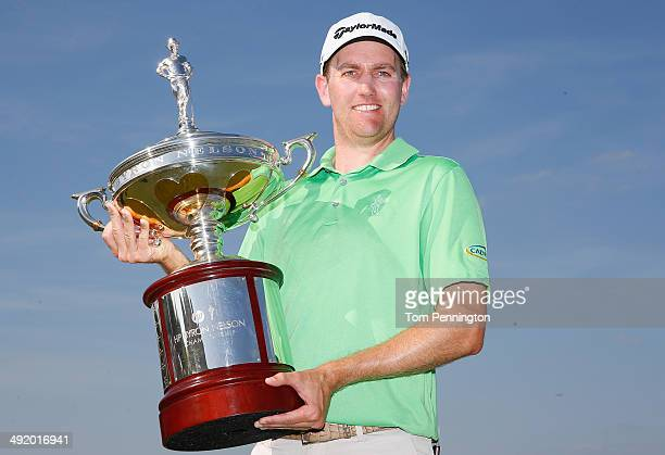Brendon Todd poses with the trophy after his victory at the HP Byron Nelson Championship at the TPC Four Seasons Resort on May 18 2014 in Irving Texas