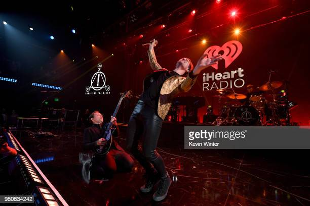 Brendon Urie of Panic at the Disco and host Harms speak onstage during the iHeartRadio Album Release Party with Panic At The Disco at the iHeartRadio...