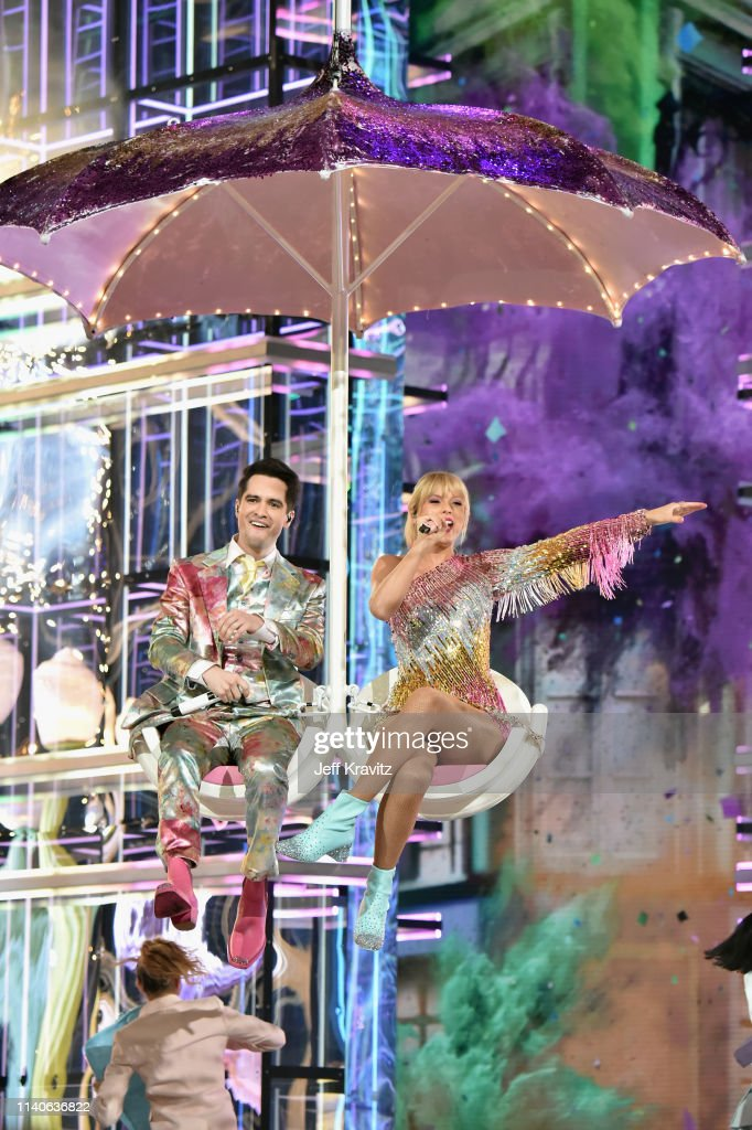 Brendon Urie of Panic! at the Disco and Taylor Swift perform onstage
