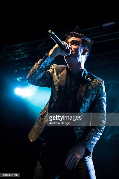 Brendon Urie of Panic At The Disco performs on stage at Manchester Arena on November 20 2013 in Manchester United Kingdom
