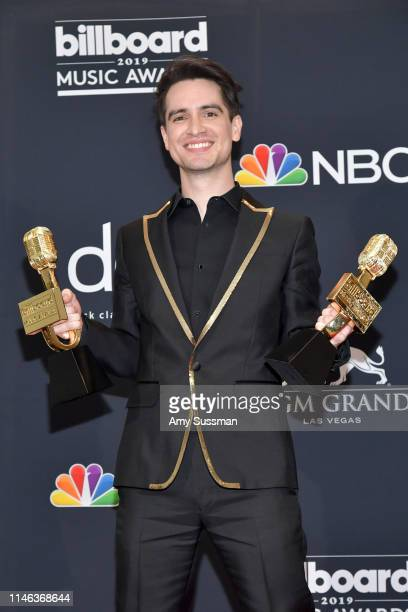 Brendon Urie of Panic at the Disco poses with the award for Top Rock Song for High Hopes in the press room during the 2019 Billboard Music Awards at...
