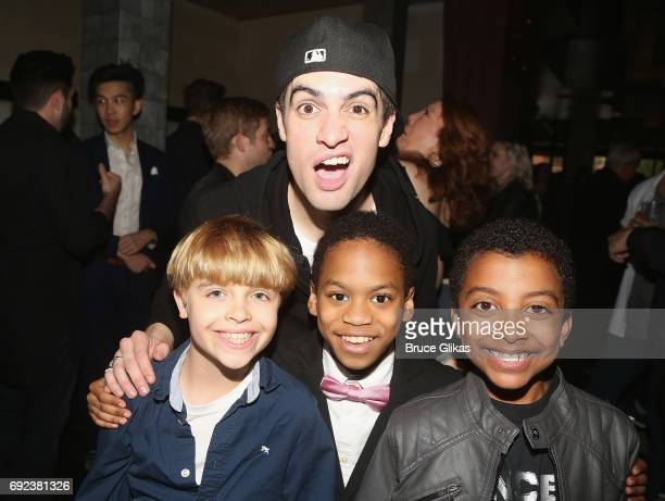 Brendon Urie poses with cast members Jake Katzman Jesus Del Orden and Devin Trey Campbell pose at a celebration for Panic at The Disco frontman...