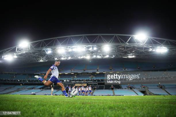Brendon Wakeham of the Bulldogs takes a conversion attempt during the round 2 NRL match between the Canterbury Bulldogs and the North Queensland...