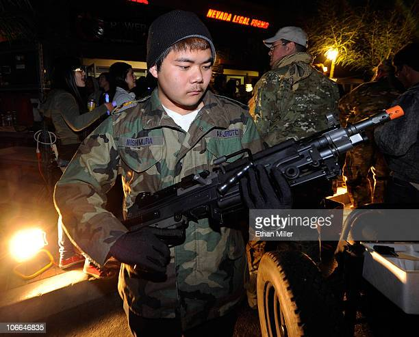 Brendyn Nishimura of Nevada looks at an Airsoft SAW machine gun on display during a launch event for the highlyanticipated video game 'Call of Duty...