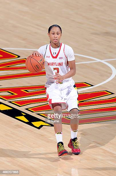 Brene Moseley of the Maryland Terrapins handles the ball against the Delaware State Hornets at the Comcast Center on December 14 2013 in College Park...