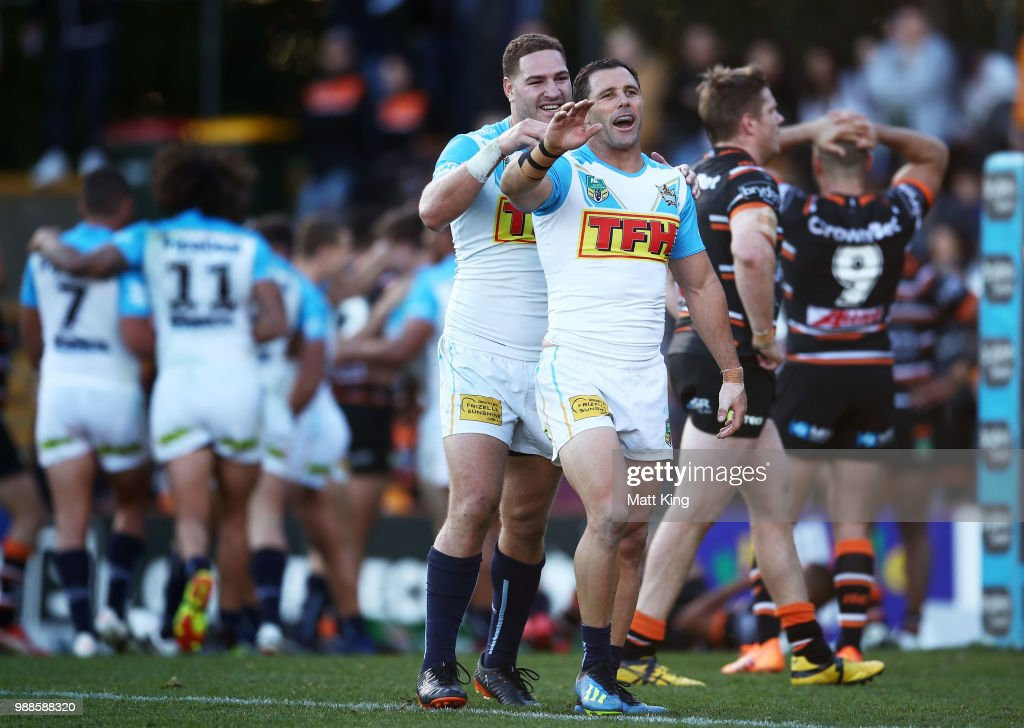 Brenko Lee (L) and Michael Gordon (R) of the Titans celebrate their final try during the round 16 NRL match between the Wests Tigers and the Gold Coast Titans at Leichhardt Oval on July 1, 2018 in Sydney, Australia.
