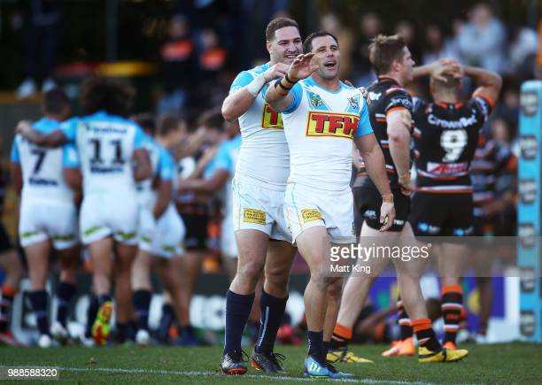 Brenko Lee and Michael Gordon of the Titans celebrate their final try during the round 16 NRL match between the Wests Tigers and the Gold Coast...