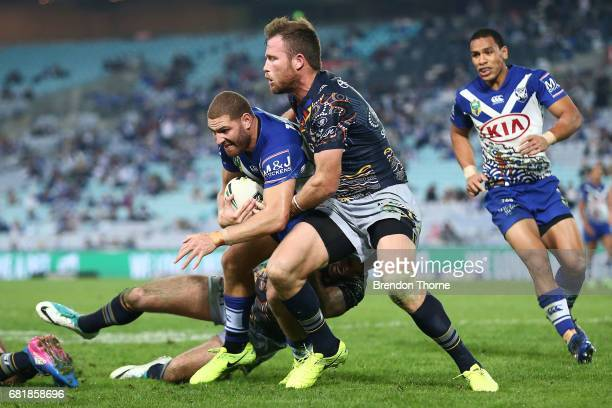 Brenko Lee of the Bulldogs is tackled by the Cowboys defence during the round 10 NRL match between the Canterbury Bulldogs and the North Queensland...