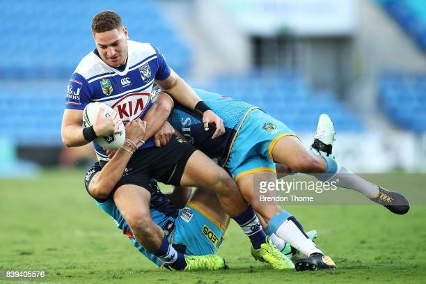 Brenko Lee of the Bulldogs is tackled by the Titans defence during the round 25 NRL match between the Gold Coast Titans and the Canterbury Bulldogs...