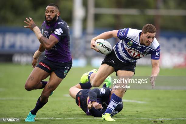 Brenko Lee of the Bulldogs maks a break during the round one NRL match between the Canterbury Bulldogs and the Melbourne Storm at Belmore Sports...