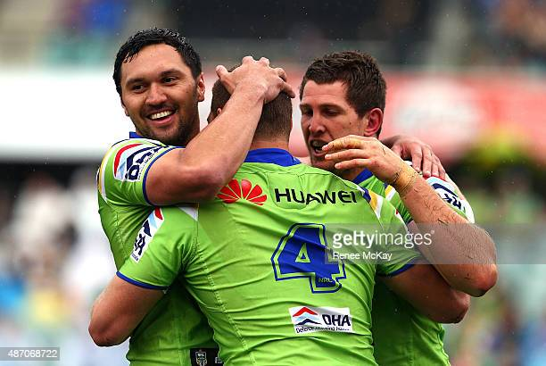 Brenko Lee of the Raiders celebrates his try with team mates Jordan Rapana and Jarrad Kennedy during the round 26 NRL match between the Parramatta...