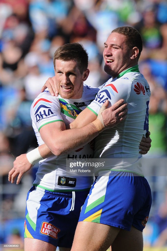 Brenko Lee of the Raiders celebrates scoring a try with Josh McCrone (L) during the round 18 NRL match between the Gold Coast Titans and the Canberra Raiders at Cbus Super Stadium on July 13, 2014 on the Gold Coast, Australia.