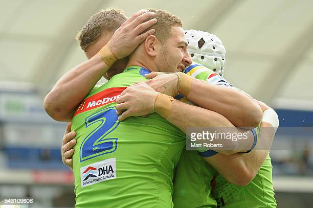 Brenko Lee of the Raiders celebrates scoring a try with team mates during the round 16 NRL match between the Gold Coast Titans and the Canberra...