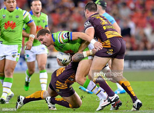 Brenko Lee of the Raiders is tackled during the round 14 NRL match between the Brisbane Broncos and the Canberra Raiders at Suncorp Stadium on June 9...